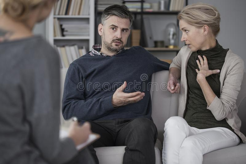 Quarreling couple with therapist royalty free stock images