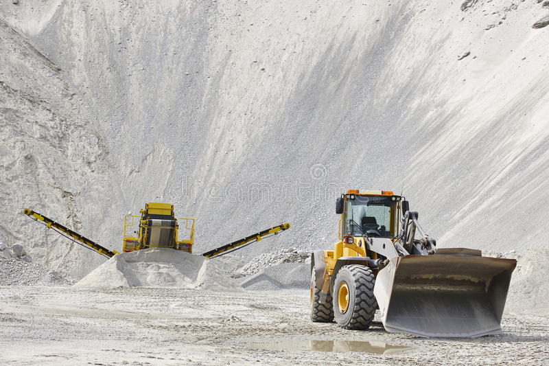 Quarry aggregate with heavy duty machinery. Construction industry royalty free stock image