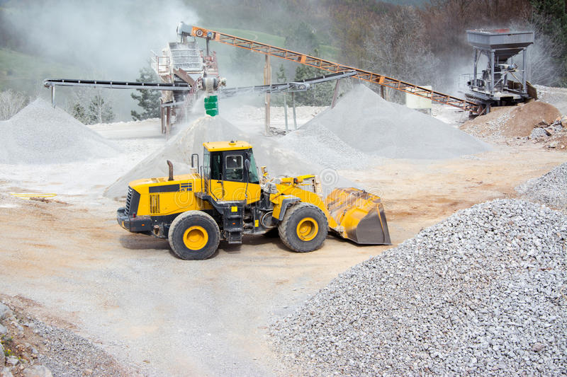 Quarry aggregate with heavy duty machinery stock photography
