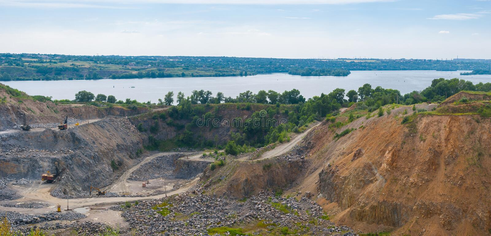 Quarry beside big river Dnepr near Dnepropetrovsk city. Ukraine royalty free stock images
