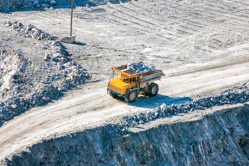 Quarry dump truck loaded with stones stock photos