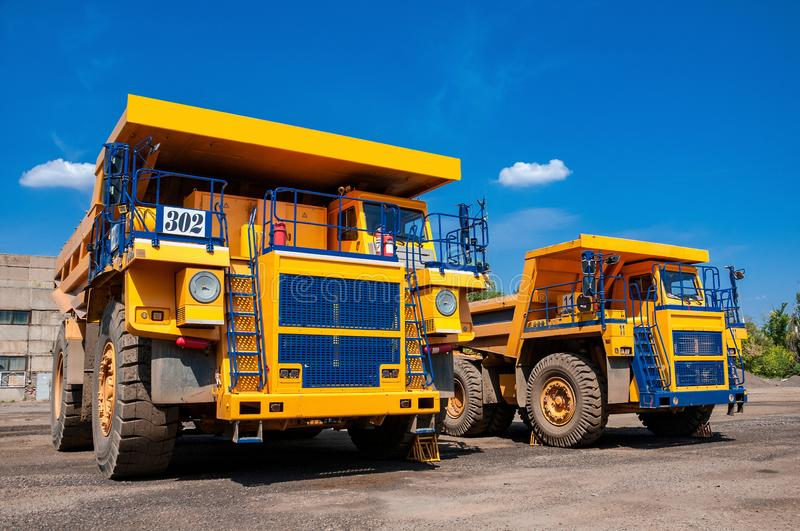 Quarry trucks at repair station royalty free stock images