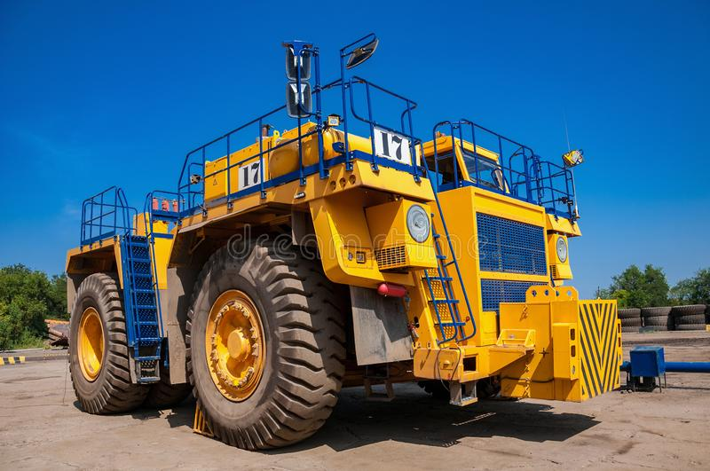 Quarry trucks at repair station royalty free stock photo