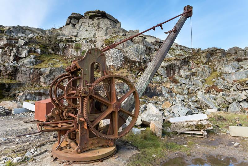 Quarry Winch. Rustly old winch crane used in a stone quarry stock photos