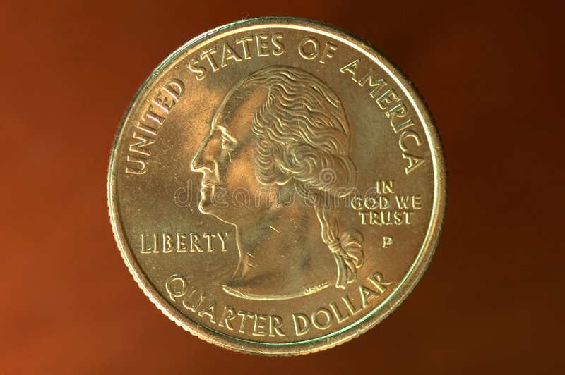 Quarter - 25 cents. 25 cents on brown background royalty free stock images