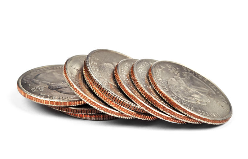 Quarter coins. Pile of one quarter coins isolated on white stock image