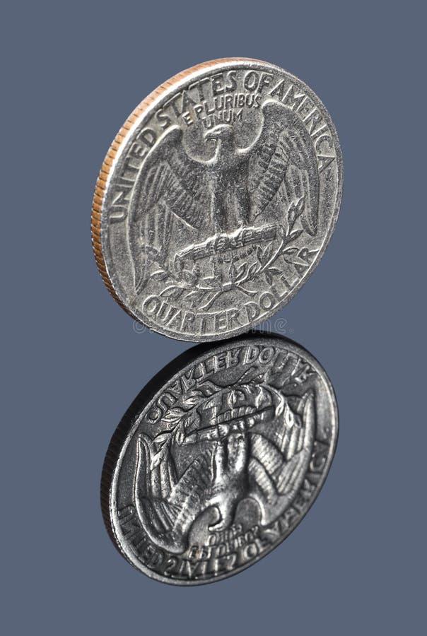 Quarter dollar coin on dark mirror background stock photo