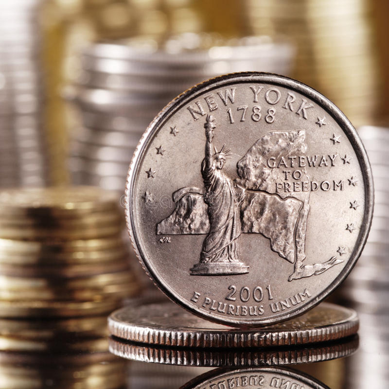 Quarter dollar. On glass table stock image