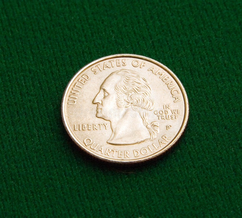 Quarter on Green. Picture of a quarter on a green felt background stock photo