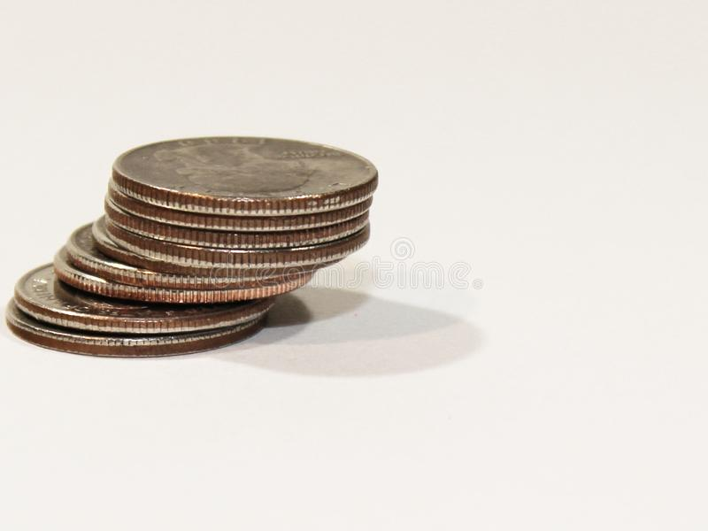 Quarter Stack Left. Stack of American quarters staggered on the left side of the frame royalty free stock photo