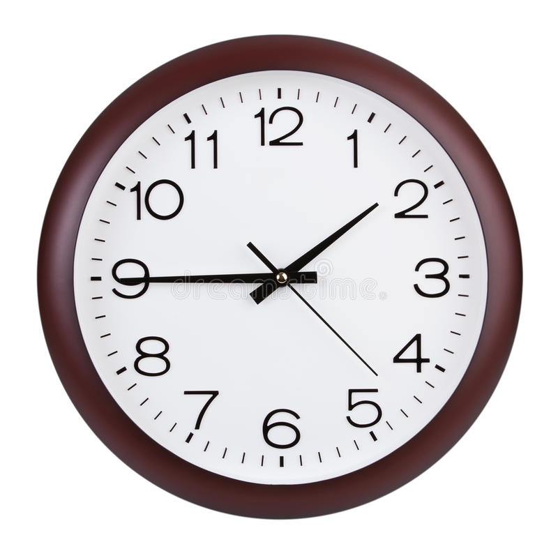 Quarter to two in the round clock stock photography