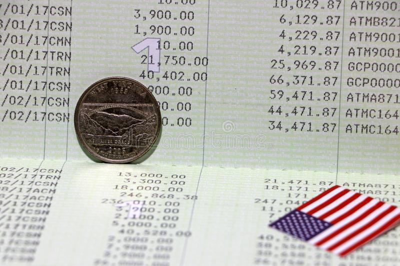 A quarter of US Dollar coins on reverse USD and mini USA flag on the book bank. Concept of Saving money or finance royalty free stock photo