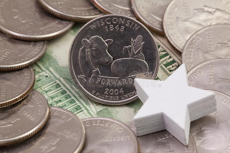A quarter of Wisconsin, quarters of USA and white star. stock images