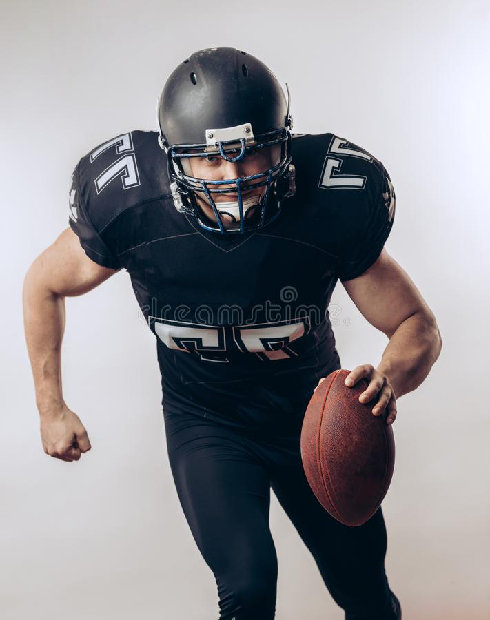 Quarterback throwing a football in a professional football game royalty free stock photo