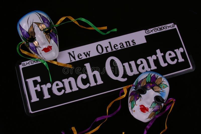 Quartiere francese e due mascherine fotografie stock libere da diritti