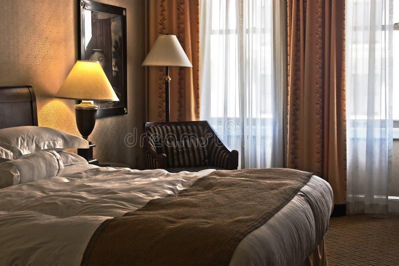 Quarto de hotel do conforto fotografia de stock