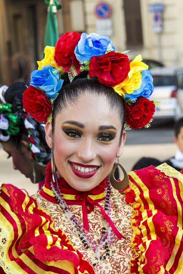 QUARTU S.E., ITALY - July 18, 2015: 29 ^ Sciampitta - International Folklore Festival – Sardinia. Portrait of a beautiful smiling girl you belong to the stock photo