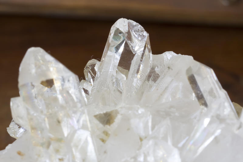Quartz. Rock crystal quartz with its characteristic, in white royalty free stock image