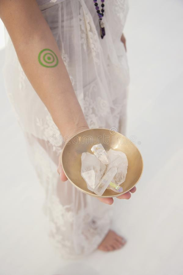Woman Holding Quartz Crystal stock photo