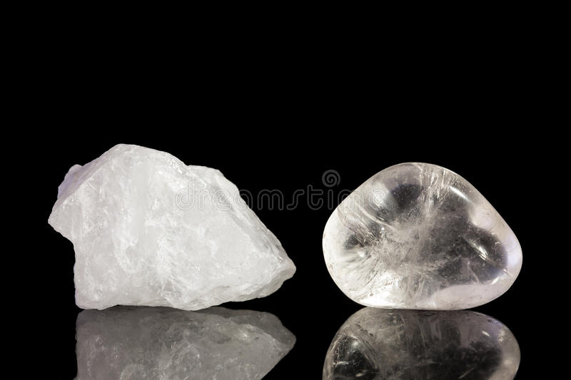 Quartz crystal, uncut and Tumble finishing. With black background and reflection stock image