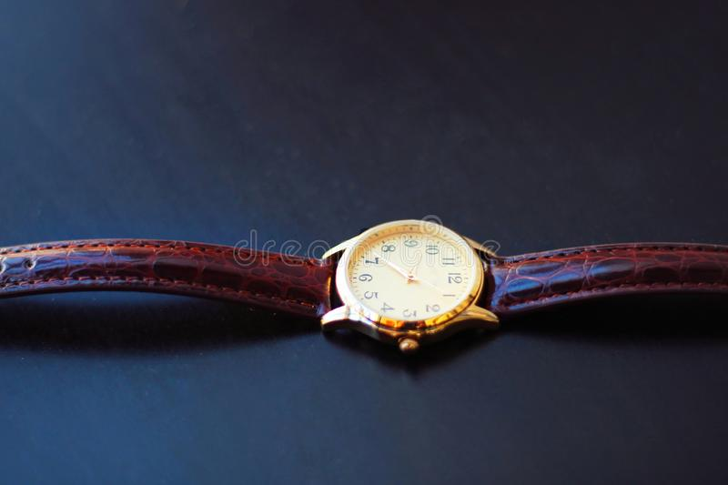 Quartz and gold watch. stock images