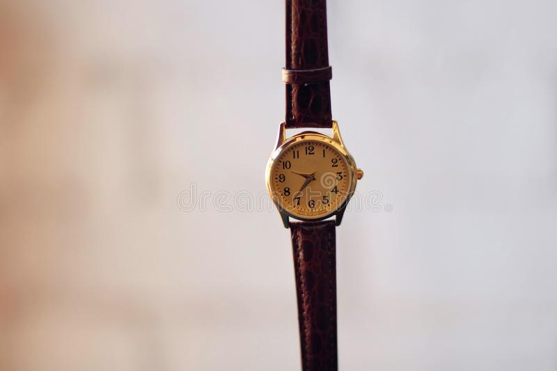 A quartz and gold watch. stock images
