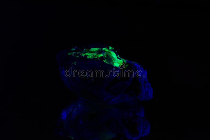 Quartz with a green fluorescent hyalite cover royalty free stock photos