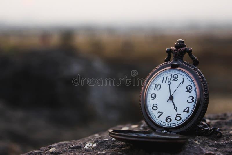 Quartz pocket analog watch kept on a rock royalty free stock photos