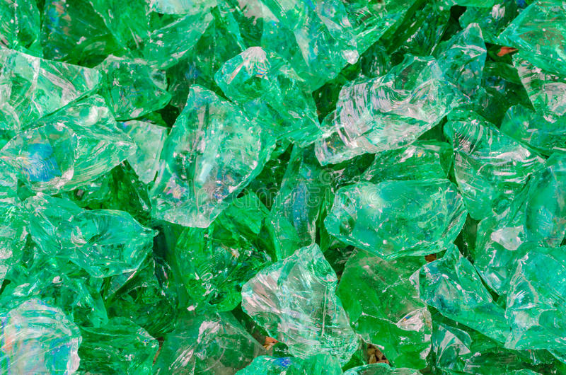 Quartz stone, glass rocks in green. Quartz stone, glass stone pieces in green as decoration for home and garden royalty free stock photos