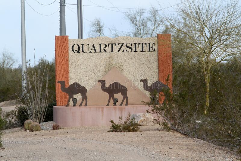 Quartzsite, Arizona Sign with Camels. This is the sign displayed as you enter Quartzsite, Arizona.  The sign has camels on it in front of a pyramid. The city of stock photography