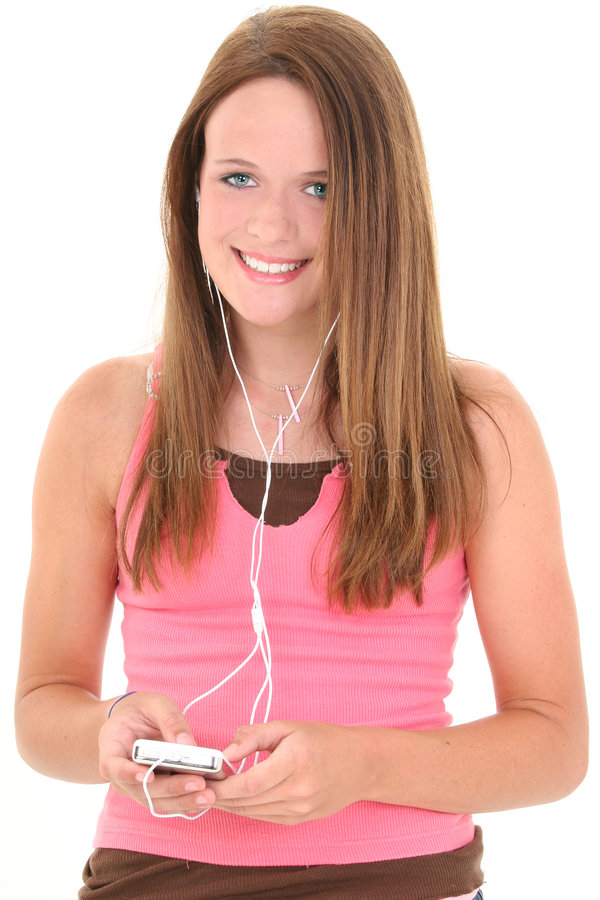 Quatorze escutas adolescentes bonita dos anos de idade a música imagens de stock royalty free
