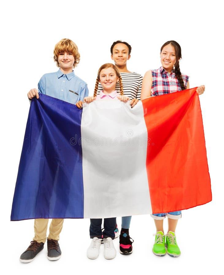 Quatre étudiants multi-ethniques de sourire des Frances images stock