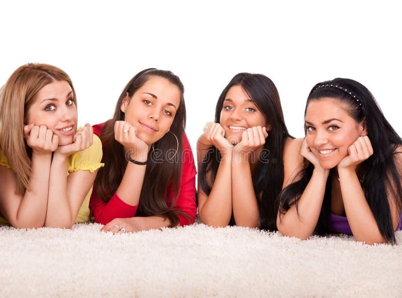 Quatre belles filles sur l'étage photographie stock libre de droits