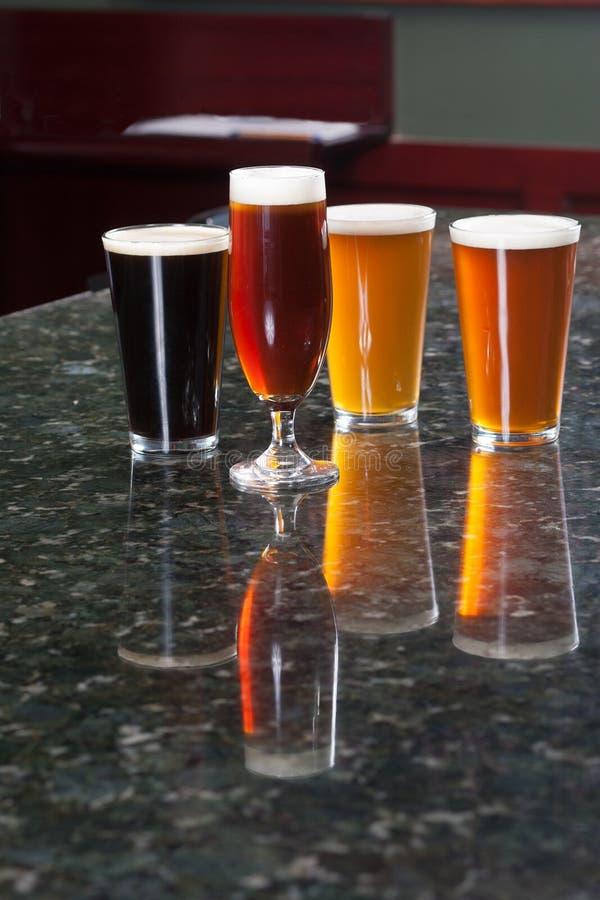 Quatre bières différentes image stock