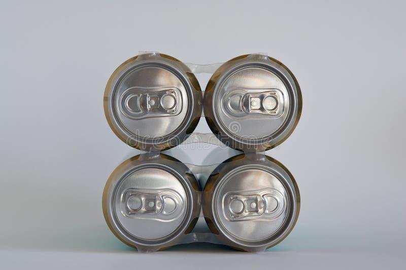 Quatre bidons de bière photographie stock libre de droits