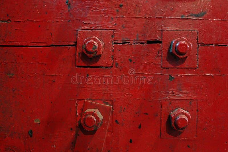 Quatre boulons rouges photos stock