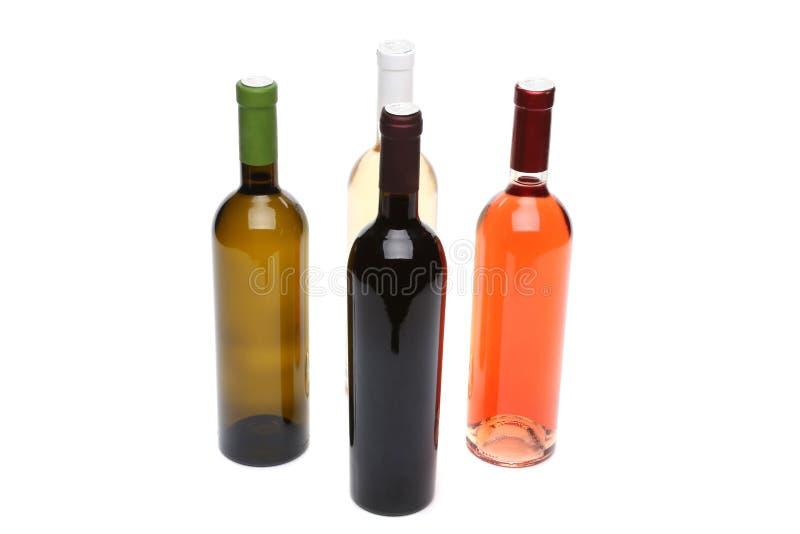 Quatre bouteilles de vin. photos libres de droits