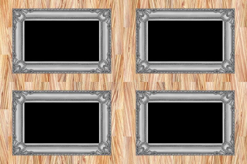 quatre cadres en bois gris sur le mur en bois moderne images libres de droits