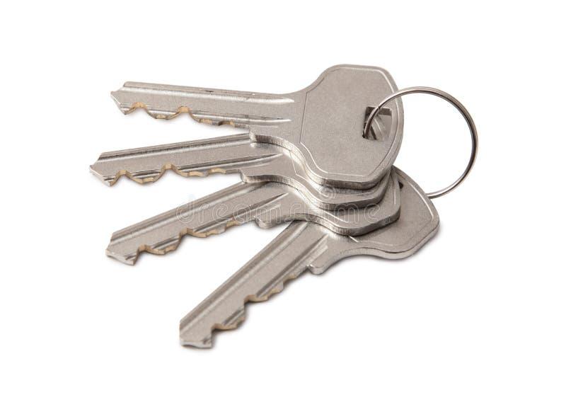 Quatre clés sur la boucle images stock