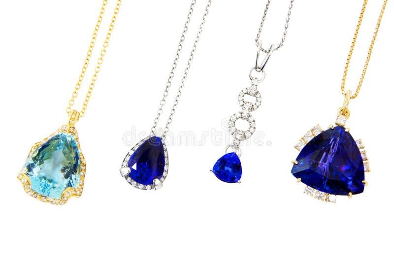 Quatre concepteur différent Pendants avec Tanzanite, aigue-marine et diamants photographie stock
