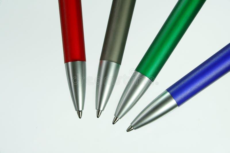 quatre crayons lecteurs photos stock