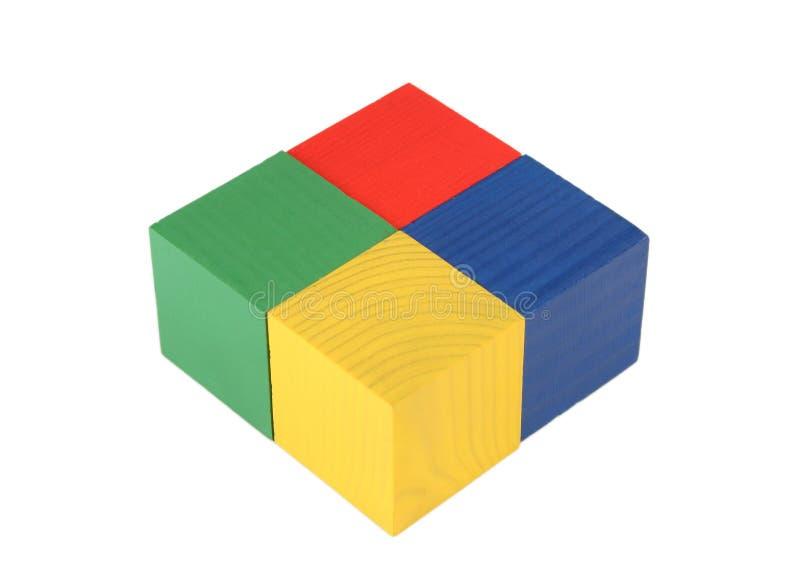 Quatre cubes en jouet photographie stock