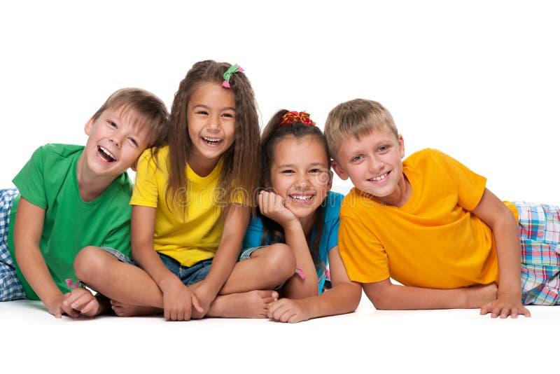 Quatre enfants riants images libres de droits