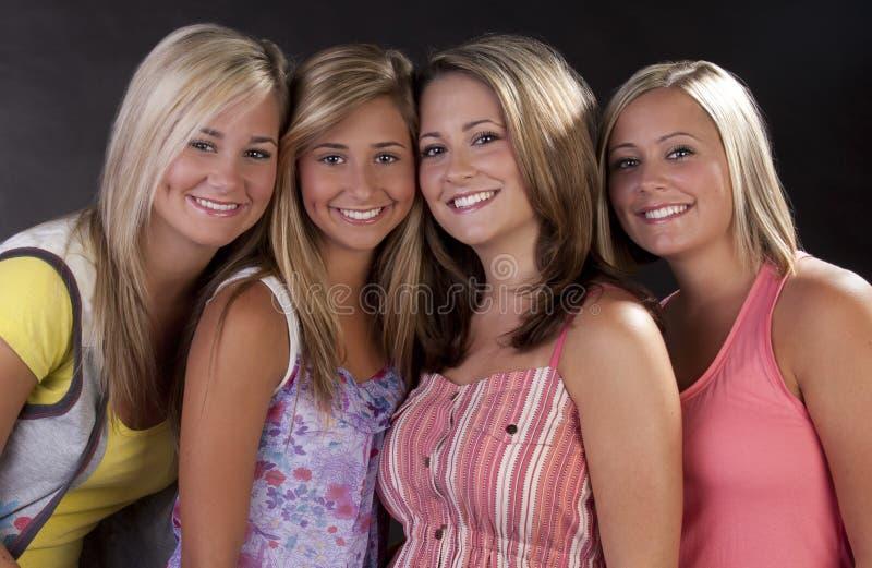 Quatre jolies femmes image stock