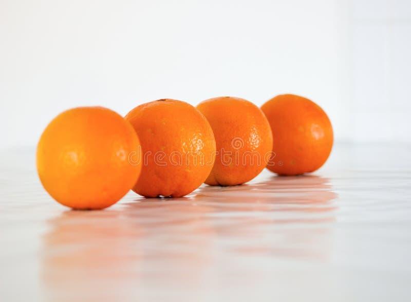 Quatre oranges image libre de droits