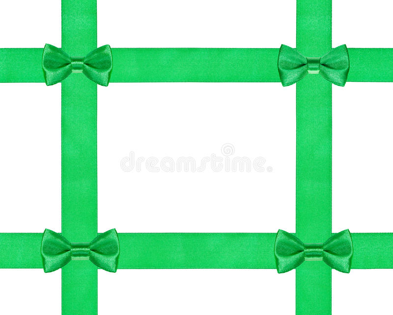 Quatre petits noeuds verts d'arc sur le ruban du satin quatre photo stock