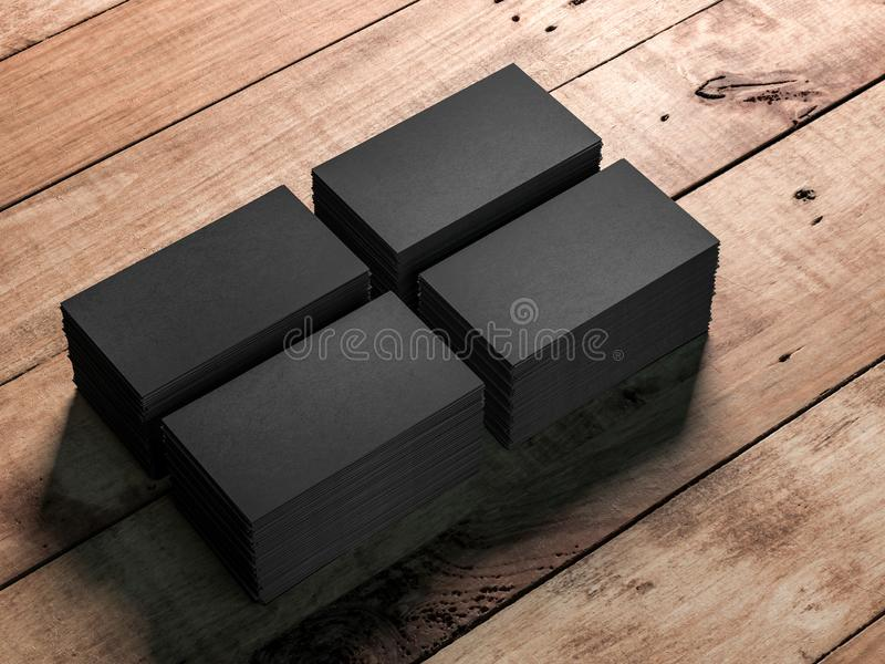 Quatre piles de cartes de visite professionnelle de visite noires sur le fond en bois de table illustration libre de droits