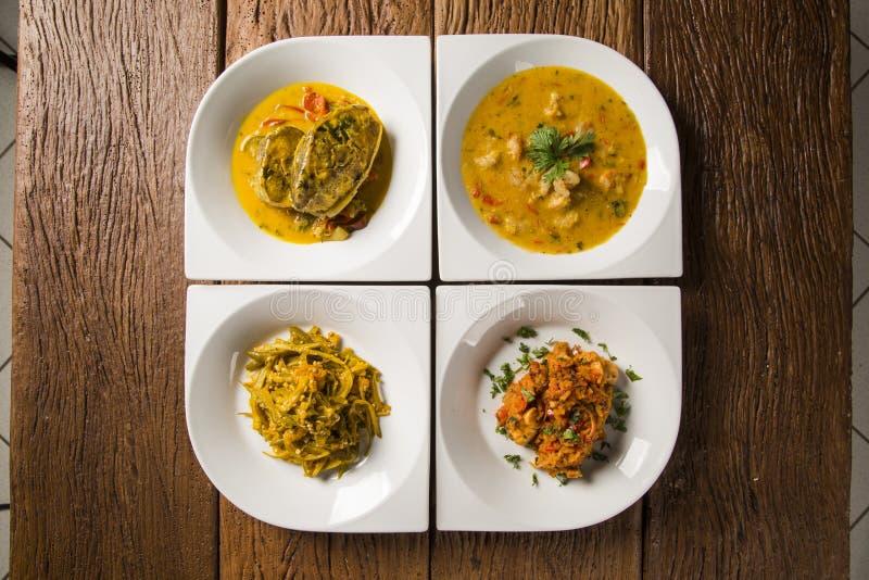 Quatre plats typiques de la cuisine de Bahian - Brésil Moqueca, caruru, crevette Bobo et risotto avec le poulpe photo stock