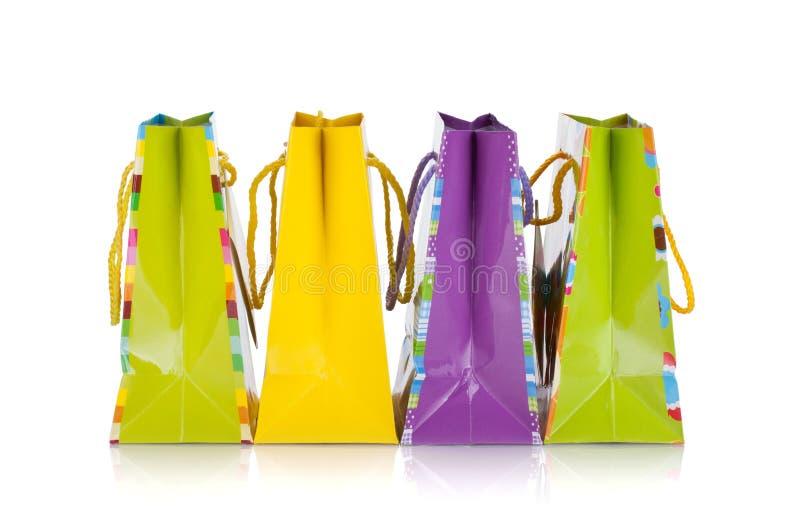 Quatre sacs colorés de cadeau images libres de droits