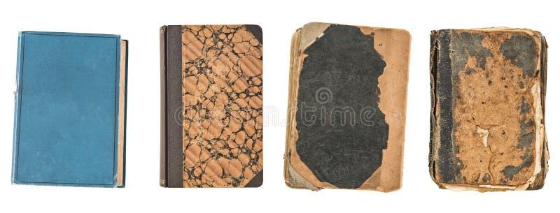 Quatre vieux livres de cru d'isolement sur le fond blanc Vieille bibliothèque images libres de droits